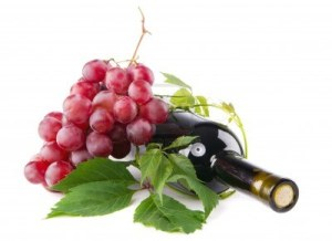 9668206-bottle-of-red-wine-with-grapes-white-background