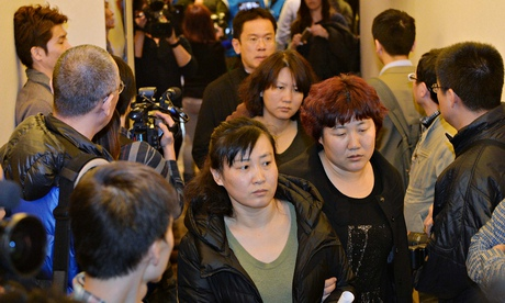 Relatives of passengers on the missing Malaysia Airlines flight MH370 arrive for a meeting with airline officials in Beijing. Photograph: Mark Ralston/AFP/Getty Images