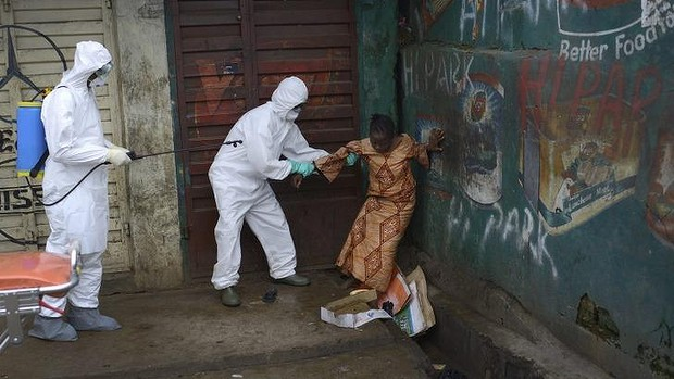 A woman suspected of being infected with Ebola is assisted by health workers to an ambulance for treatment in Freetown, Sierra Leone. Photo: The New York Times Read more: http://www.smh.com.au/world/ebola-cases-could-reach-14-million-in-4-months-cdc-estimates-20140924-10l52x.html#ixzz3EB2yhkRf